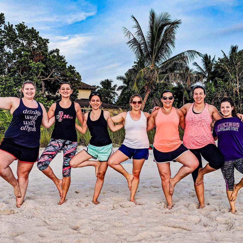 This image has an empty alt attribute; its file name is yoga-on-beach1-1024x1024.jpg